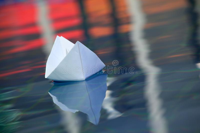 Paper boat swimming pool day royalty free stock photography