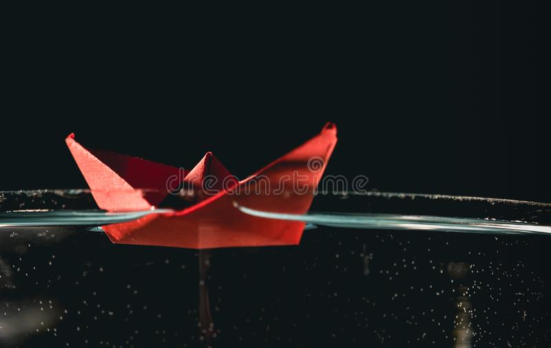 Paper boat on water royalty free stock photography