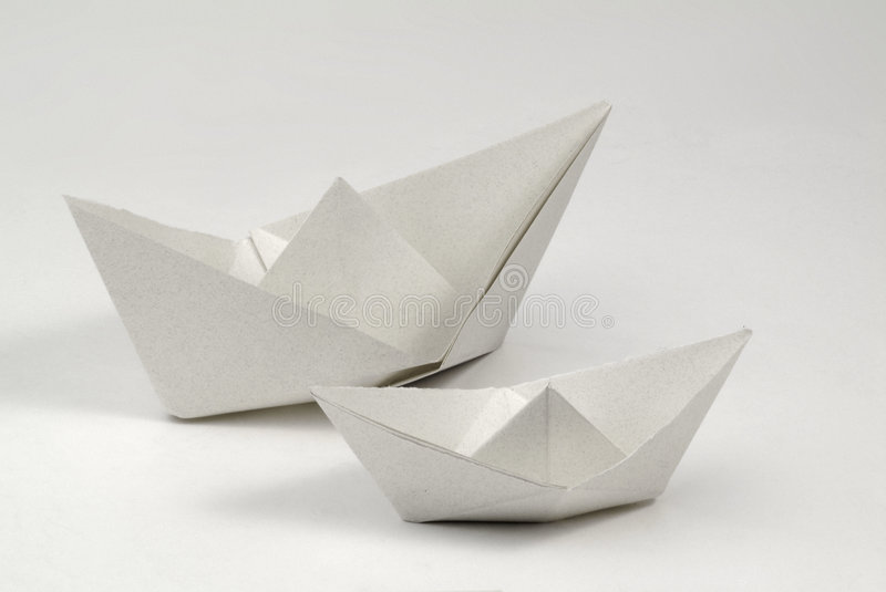 Paper boats. Two paper boats made from recycled paper royalty free stock photography