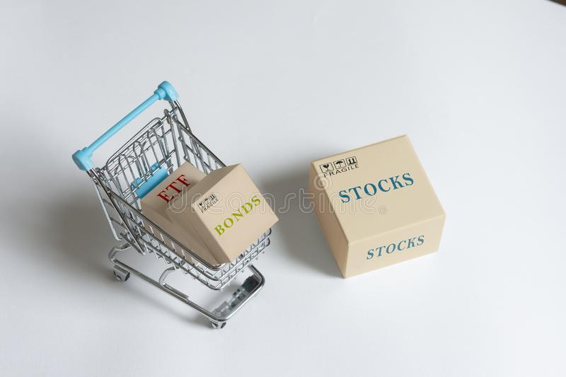 Paper boxes of financial instruments. stocks, bonds,ETFs, in shopping cart stock photo