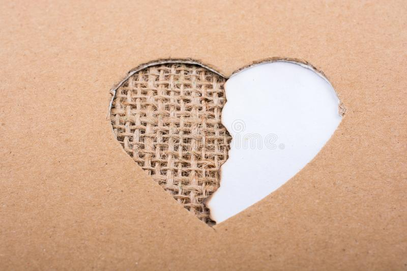 Paper and canvas seen through heart shape stock photo