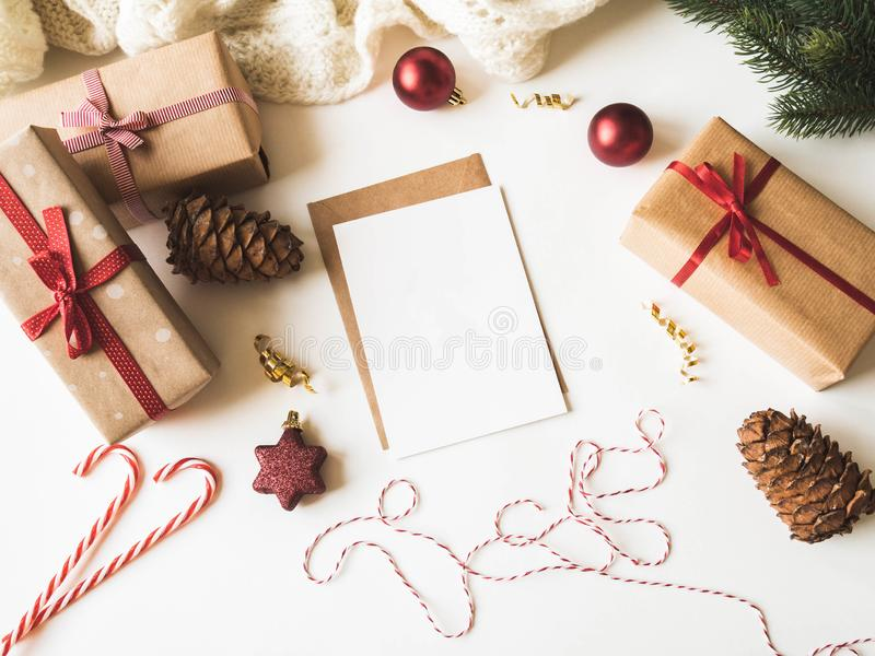 Paper card for letter, envelope and xmas decoration. Flat lay for Merry Christmas or Happy New Year. top view. Copy space. Paper card for letter, envelope and stock image