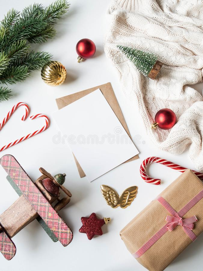 Paper card for letter, envelope and xmas decoration. Flat lay for Merry Christmas or Happy New Year. top view. Copy space royalty free stock image