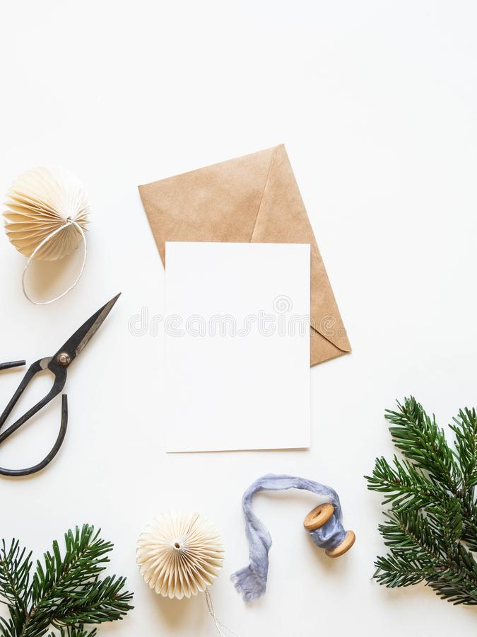 Paper card for letter, envelope and xmas decoration on white background. Top view royalty free stock image
