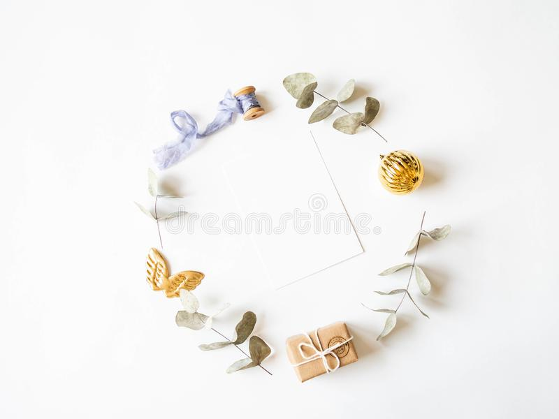 Paper card for letter and pastel xmas decoration round frame. Flat lay for Merry Christmas or Happy New Year. top view. Copy space royalty free stock image