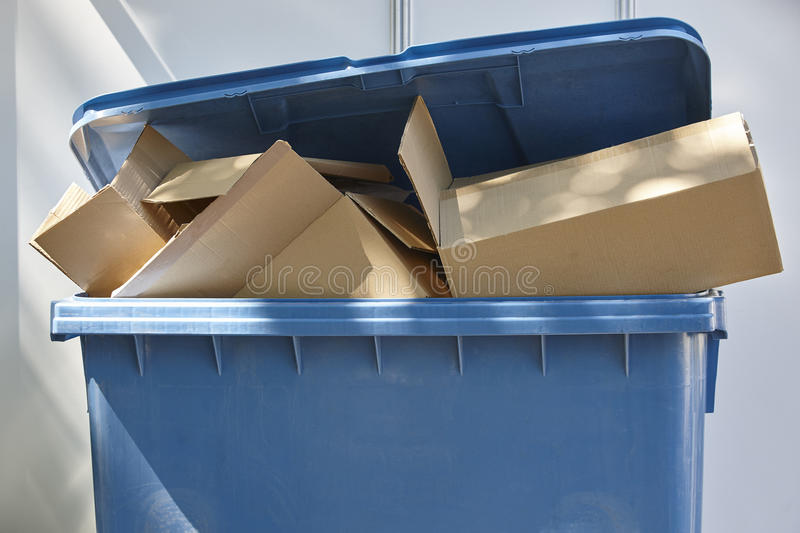 Paper and cardboard trash container. Recycling. Clean cities. Horizontal stock photos