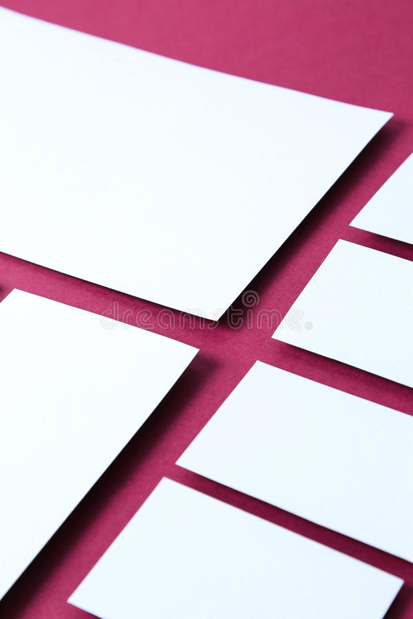 Paper cards. On a pink background stock photography