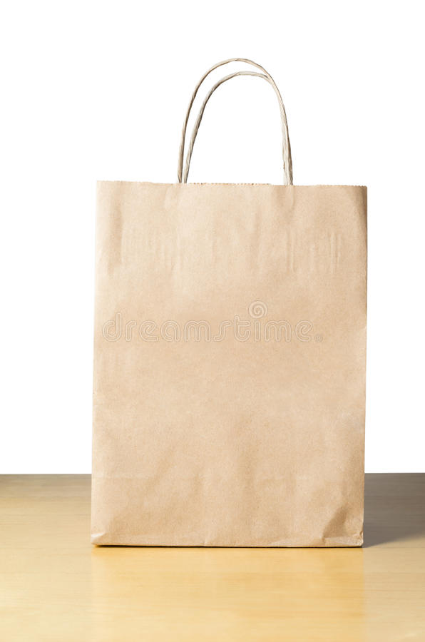 Paper Carrier Bag On Table Royalty Free Stock Photos
