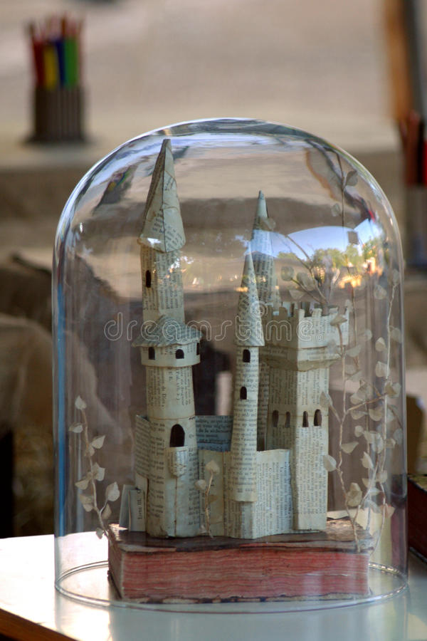 Paper castle. Newspaper castle inside a glass dome stock photo