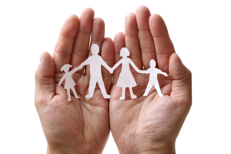 Paper chain family protected in cupped hands. Cutout paper chain family with the protection of cupped hands, concept for security and care royalty free stock photo