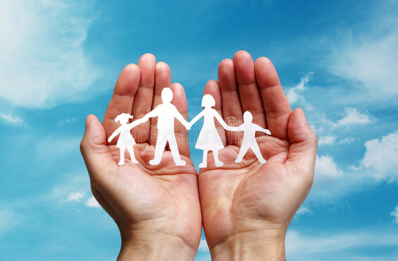 Paper chain family protected in cupped hands. Cutout paper chain family with the protection of cupped hands, concept for security and care stock images