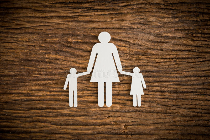 Paper chain family symbolizing. On wooden background. love family concept royalty free stock image