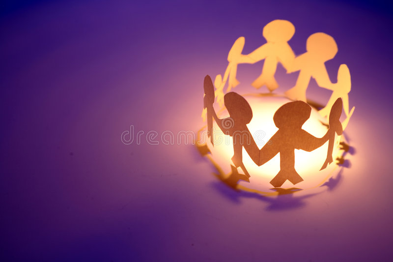 Paper-chain people holding hands stock images