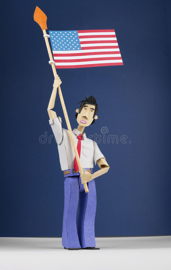 Download Paper Figurine Holding USA Flag Stock Image - Image: 29918371