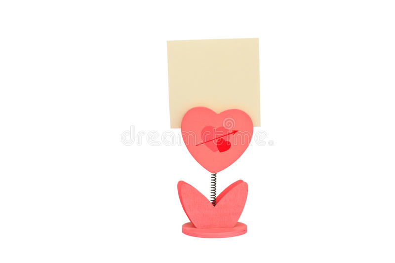 Paper clip. Blank note paper and heart paper-clip, on white background royalty free stock images