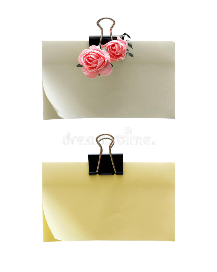 Paper-clip holding blank notes isolated on white background stock photography