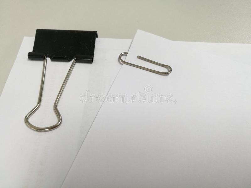 Paper clip on paper background. pack paper stock photography