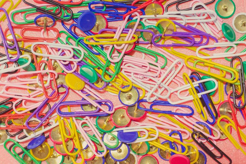 Paper clips and buttons of colorful flowers. Stationery for work and study process stock photography