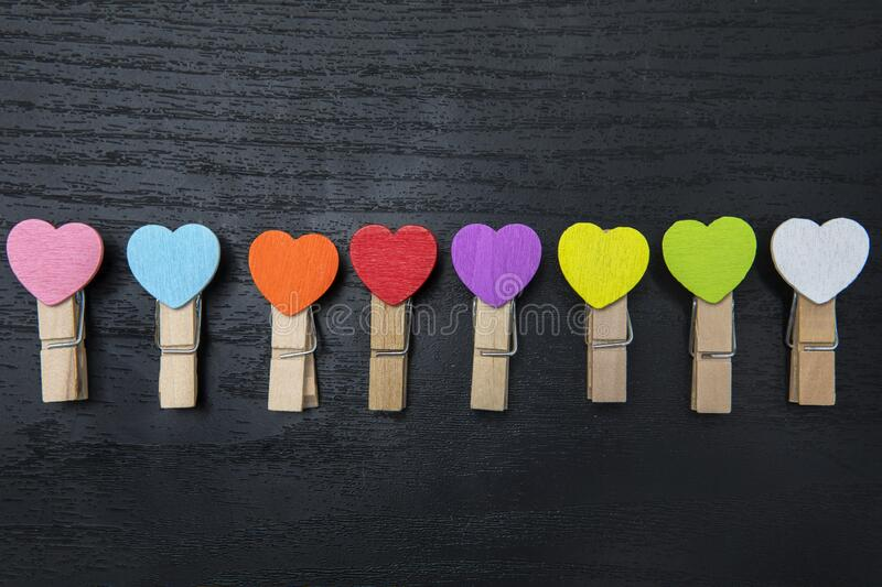 Paper clips with colorful paper heart shape stock photos