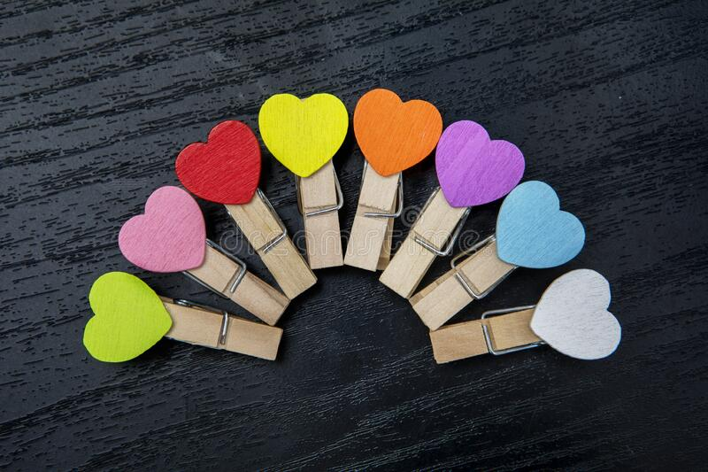 Paper clips with heart shape arranged on the table stock image