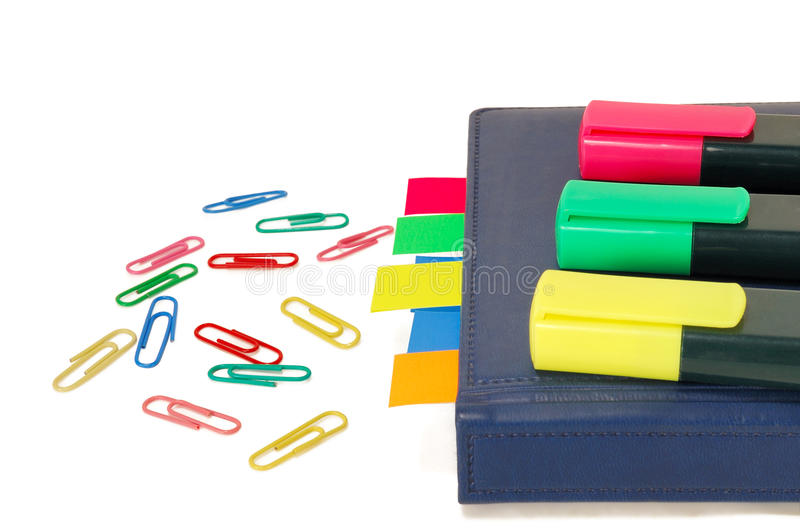 Paper clips, markers, notebook with tabs royalty free stock photography