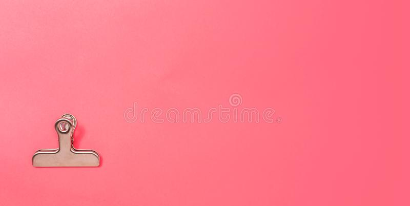 Paper clips office stationary. Paper clips office supply stationery on a pink paper background royalty free stock images
