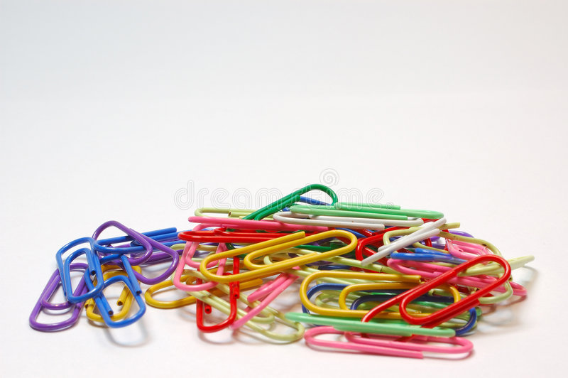 Paper clips over white. stock photo
