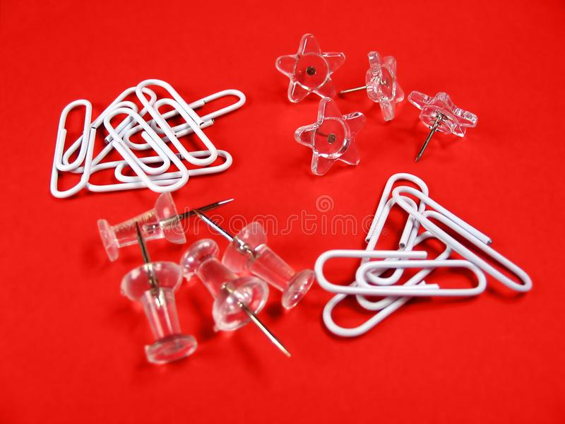 Download Paper Clips And Push Pins Over Red Background Stock Image - Image: 399349