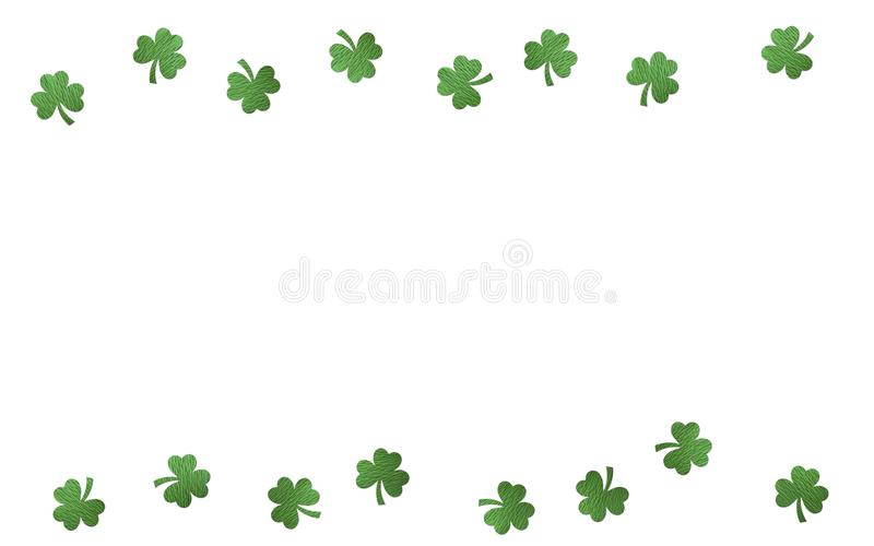 Paper clover leaves on the white background. Lucky shamrock, St.Patrick`s day holiday symbol. Space for text, top view. stock photo