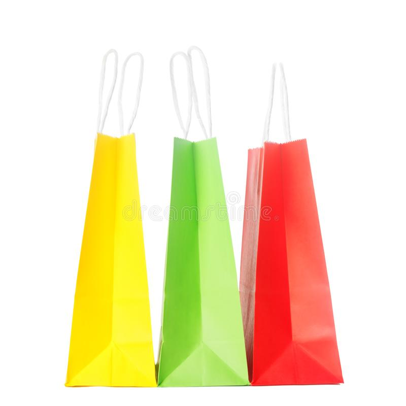 Paper colourful shopping or gift bags isolated on white background royalty free stock photo