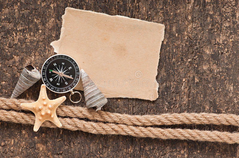 Paper, compass, rope and seashell royalty free stock photos