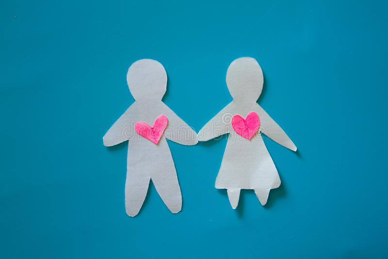 Paper couple on blue background royalty free stock photography