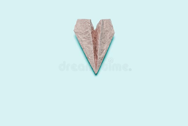 Paper craft airplane on a blue background royalty free stock images