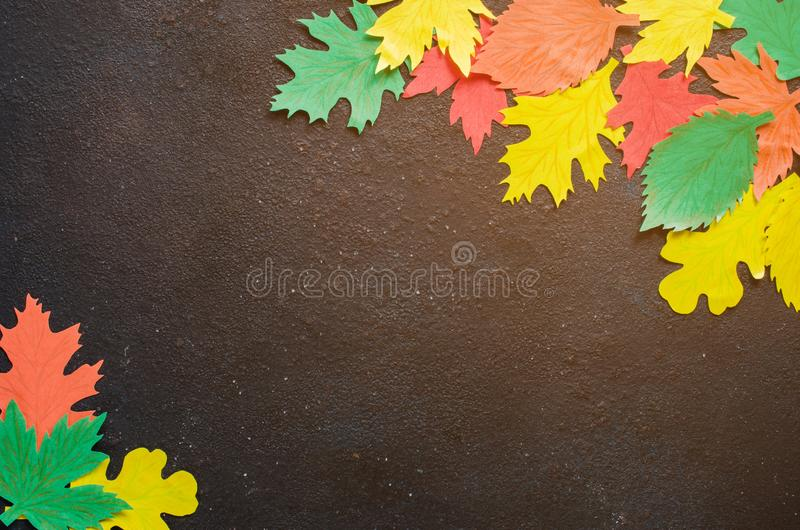 Paper craft, red and yellow Autumn leaves.Top view on flat lay on dark concrete background stock photos