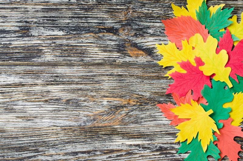 Paper craft, red and yellow Autumn leaves.Top view on flat lay on vintage wooden background stock photo