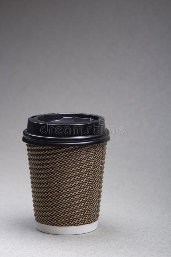 Paper cup with coffee cappuccino on grey background Close up royalty free stock image