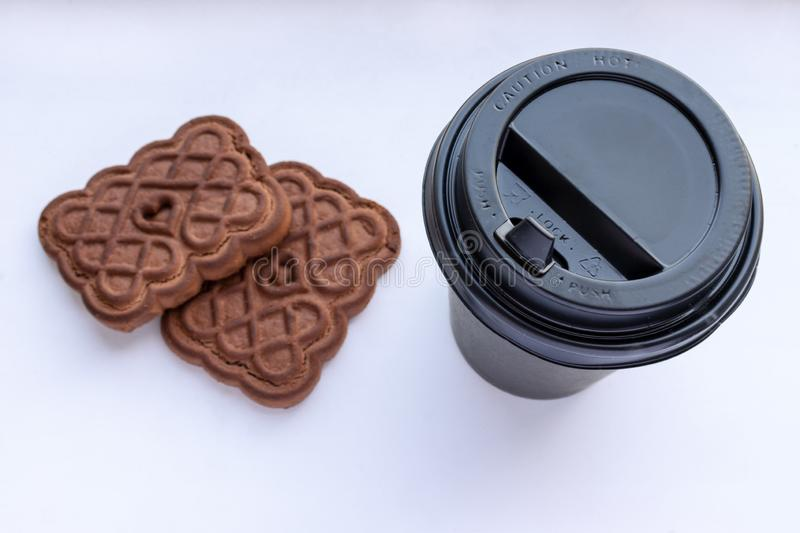 Paper cup of coffee and cookie on white background royalty free stock images