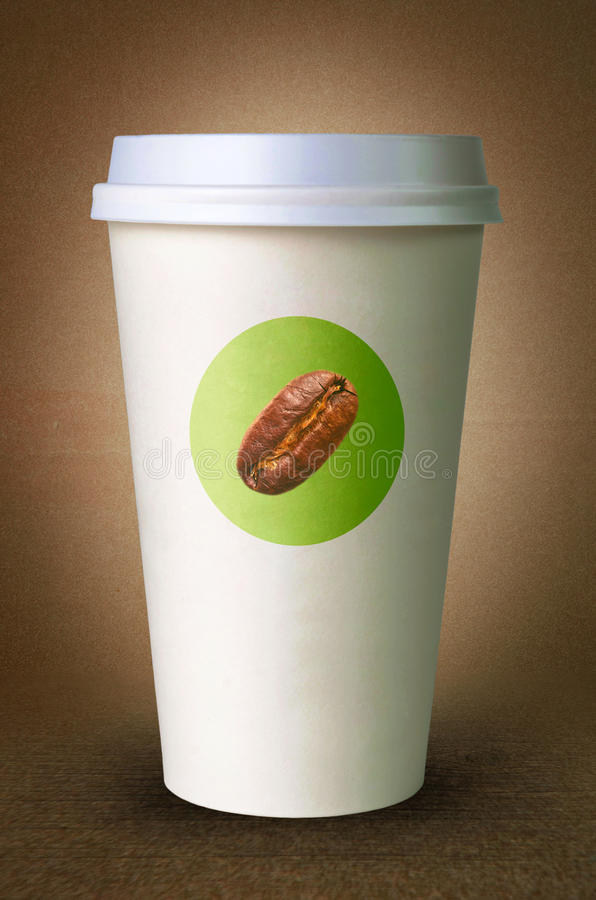 Paper cup for coffee with logo. Before brown background stock photography