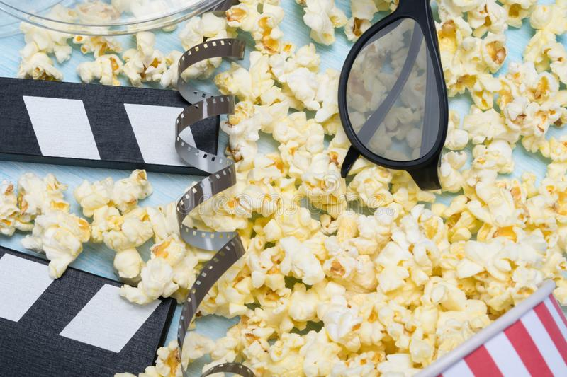 Paper cup concept with popcorn and 3-D glasses, top view royalty free stock images