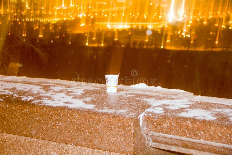 A paper cup on a granite wall is a clean city stock photo