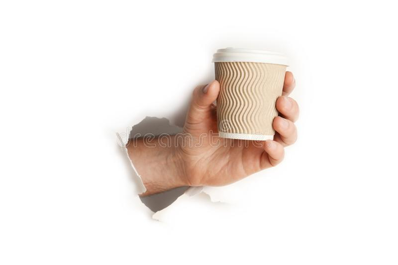 Paper  cup of hot coffee or tea in hand isolated on white background stock photography