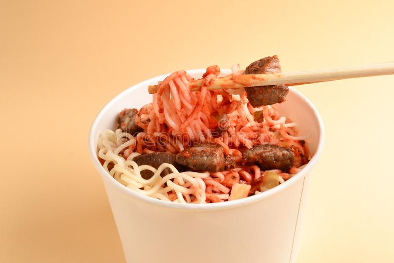 Paper cup with instant ramen noodles with beef and vegetables. Top view stock photography