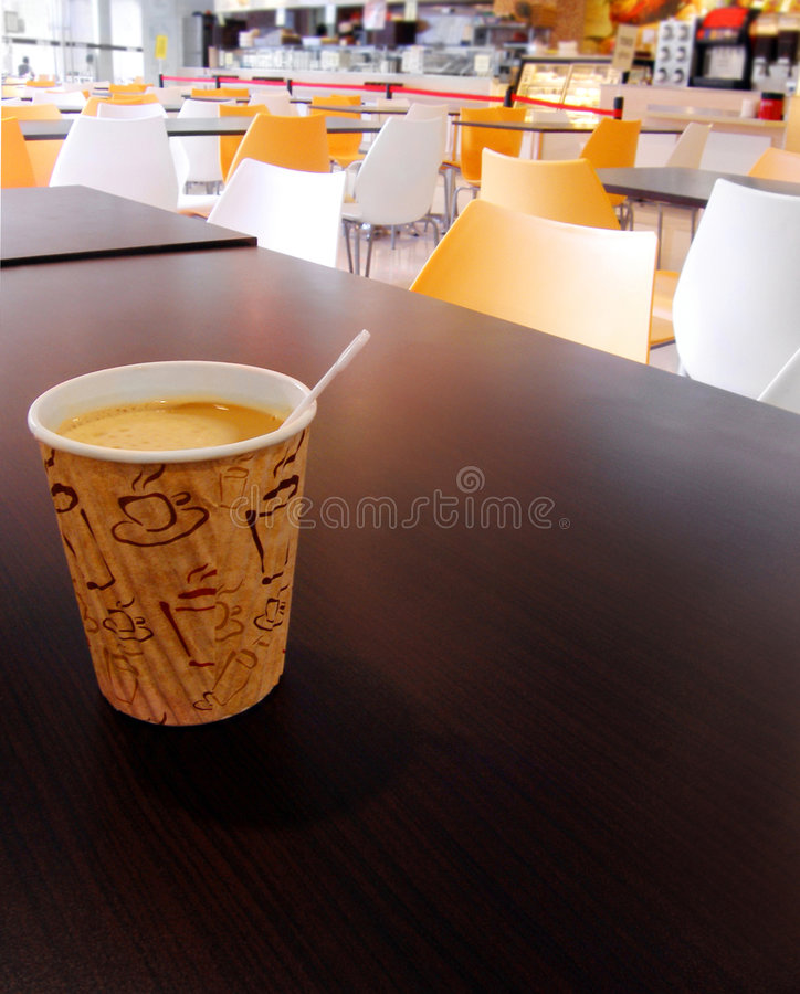 Free Paper Cup Of Coffee On Cafeteria Table Top Stock Photography - 8290172