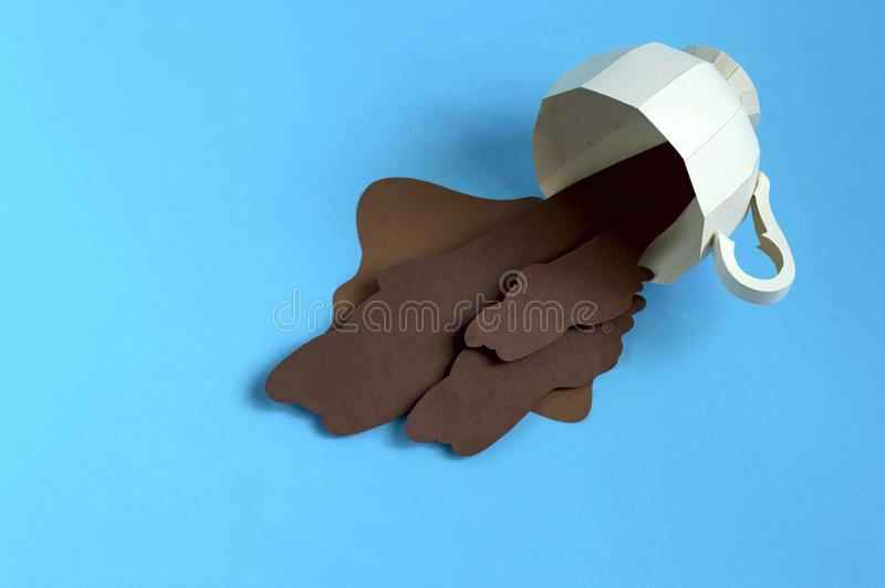 Paper cup with spilled paper coffee. Volumetric handmade paper objects. Paper art and craft. Trendy hobby. Minimal artistic food concept stock image