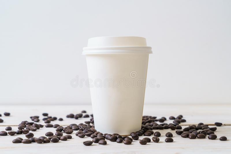 Paper cup of takeaway coffee. On wood background stock photos