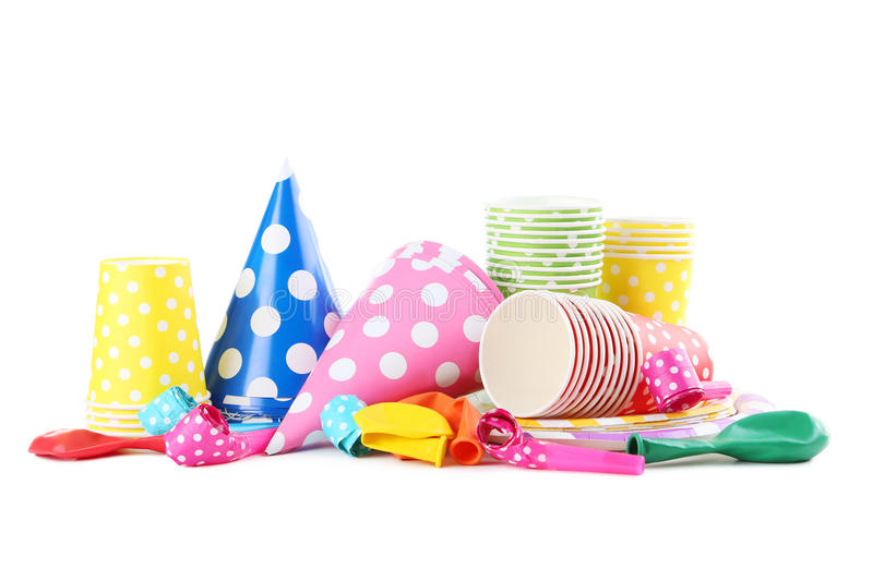 Paper cups with caps, whistles and balloons royalty free stock photography