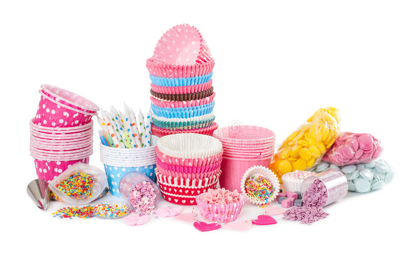 Paper cups for cupcake and colorful sprinkling for decorating. Isolated on white background stock photos