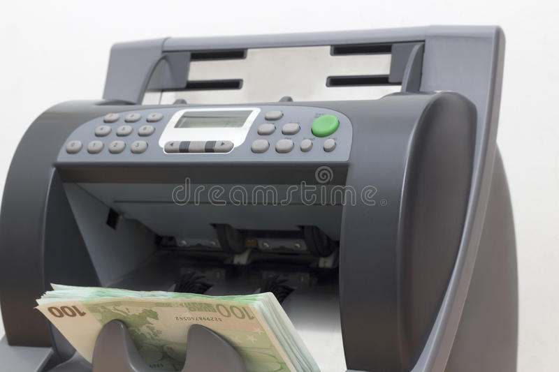 Paper Currency in the Money counting Machine royalty free stock photography