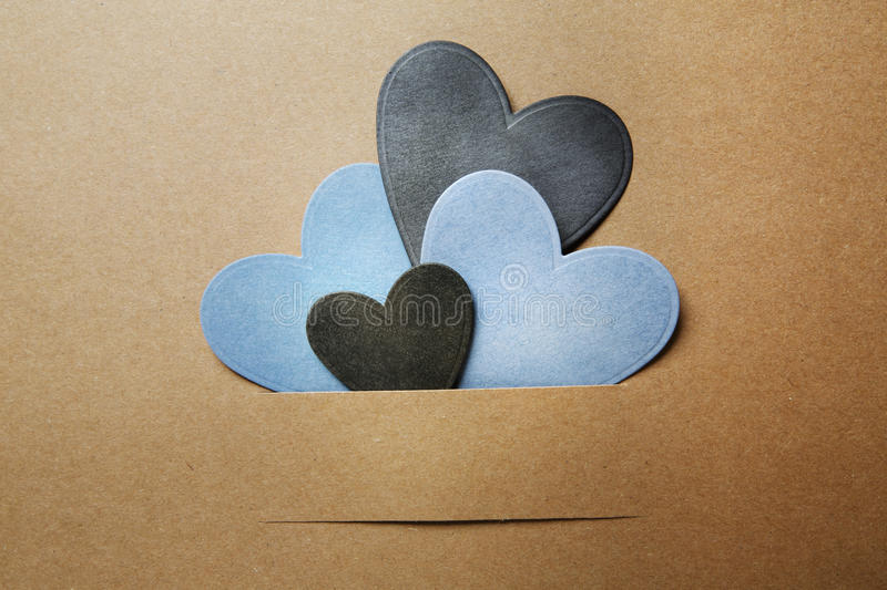 Paper cut blue and black hearts royalty free stock photo