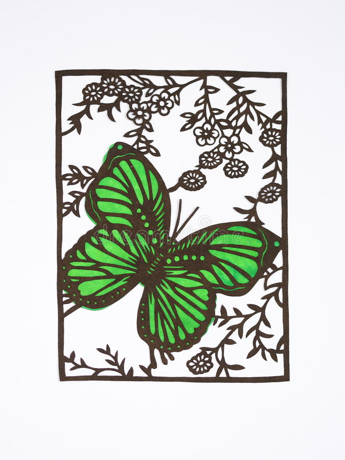 Paper-cut of butterfly. Paper-cutting is a traditional Chinese folk art. Paper-cut of a butterfly and flowers stock image